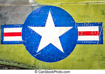 Military plane with star and stripe sign. - Part of military...
