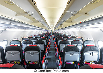 Vanishing row of black and red seats in airplane. - Modern...