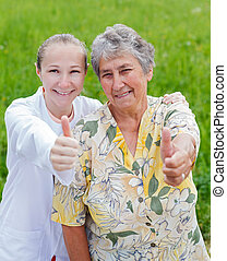 Elderly care - Happy elderly woman satisfied with her...