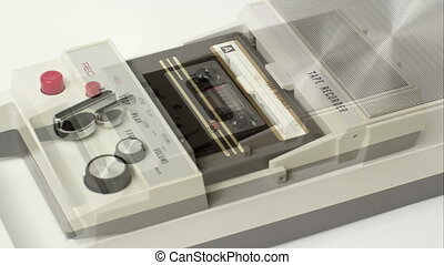 sequence of old audio cassettes in a retro tape player