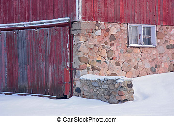 Winter on the Farm - Closeup of a weathered red barn with...