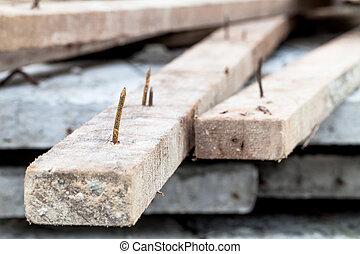 rusty nail - sharp rusty nail stick on wood