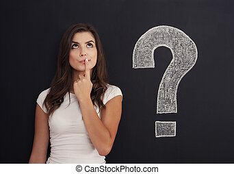 Woman with question mark on blackboard