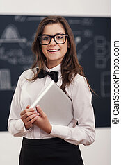 Happy female teacher in classroom