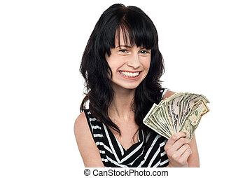 Smiling pretty girl with cash - Young smiling girl holding...
