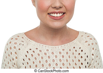 Girls smiling face, cropped image - Cropped image of face of...