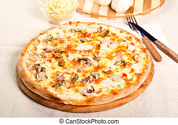 Seafood pizza - Pizza on a wooden board