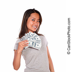 Smiling asiatic young woman holding cash money - Portrait of...