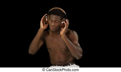 super cool young guy listening to music on headphones
