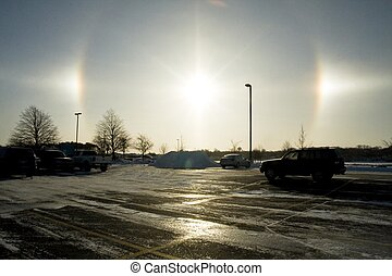 Sun Dog - A sun dog glaring in the sky and shining off the...
