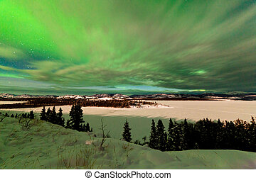 Clouds and Northern Lights over Lake Laberge Yukon - Light...
