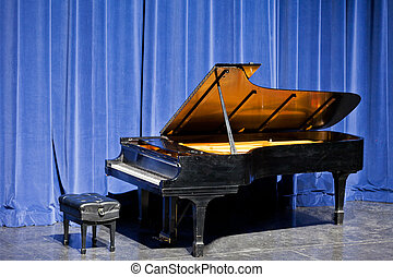 Open grand piano on stage with blue velvet cutain