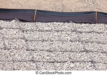 Gravel wire mesh bank revetment erosion control - Gravel and...