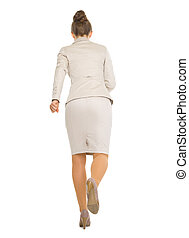 Full length portrait of running business woman . rear view