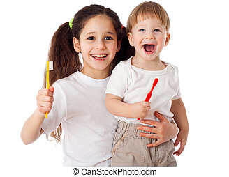 Girl teaches boy brushing the teeth - Girl teaches little...