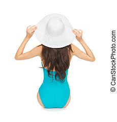 model sitting in swimsuit with hat - picture of model...