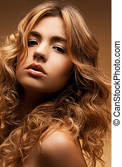 woman with long curly hair