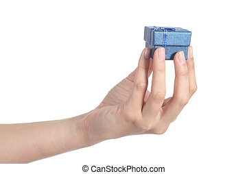Woman hand showing a little gift box