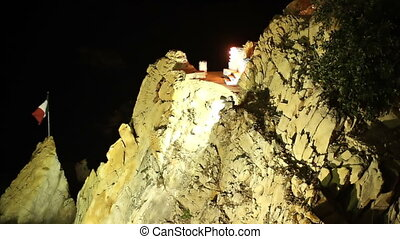 shots of the famous cliff divers in acapulco, mexico at night