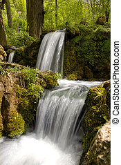 Spring water - small waterfall with a clear drinking water