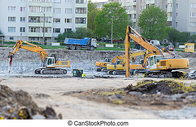 Several excavators on construction site