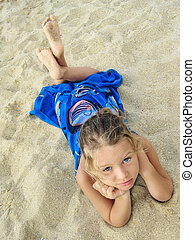 pretty young girl lying on the beach - pretty young girl in...