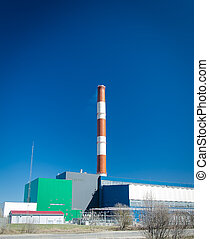 Electric power plant over blue sky.