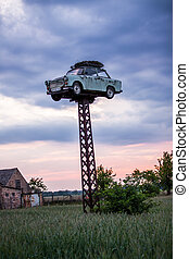 Trabant - old Trabant elevated on a pole with a storks nest...