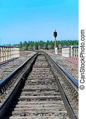 Empty railroad track with semaphore signal