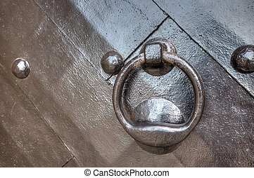 A strong wooden door with heavy rivets - A strong wooden...