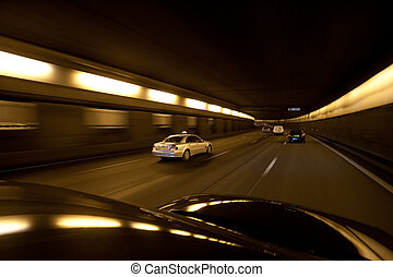 Speeding Traffic on Paris Freeway Traffic speeding along a...
