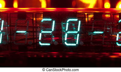 a collection of led and lit-up clocks and timers in the same...