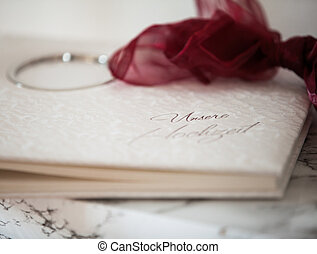 book - white book with ribbon