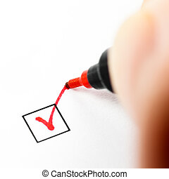 Checkbox mark - Hand with red pen marking a check box