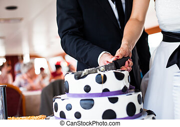 wedding cake - couple cutting wedding cake with dalmatian...