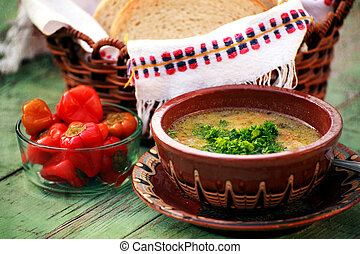 bulgarian soup - fresh soup and red hot papper in textured...