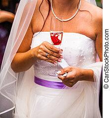 bride holding champaign glass