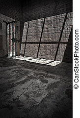 Prison Cell - Sunlight shines through the barred door of a...