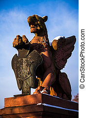 griffin - statue of a griffin with coat of arms