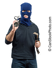 Isolated Burglar - Isolated burglar holding a crowbar and a...