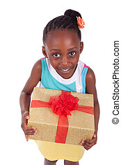 Young African American little girl holding a gift box,...