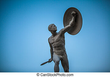 male statue - statue of an athlete with a shield and a sword...