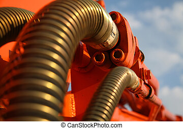 technical abstraction - details excavator hydraulic hoses...