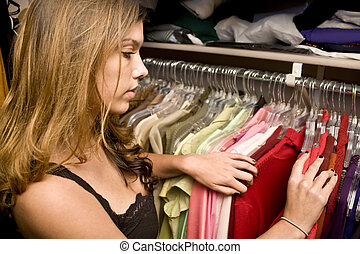 Looking through closet - Woamn searching through her closet...