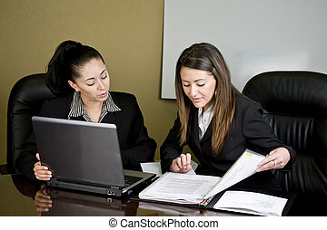 Women having a meeting - Two women at conference table...