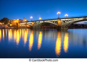 Triana Bridge - The Isabel II bridge of Seville, also known...