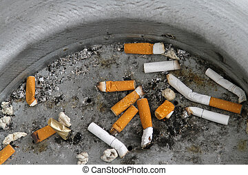 Cigarette butts discarded properly in ashtray