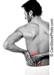 Young man holding his lower back in pain