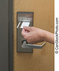 Keycard entrance swipe - Keycard being inserted in...