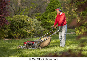 Mowing lawn - Senior man mowing overgrown lawn